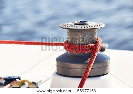 Sheet on the winch on a yacht on the background of blue water