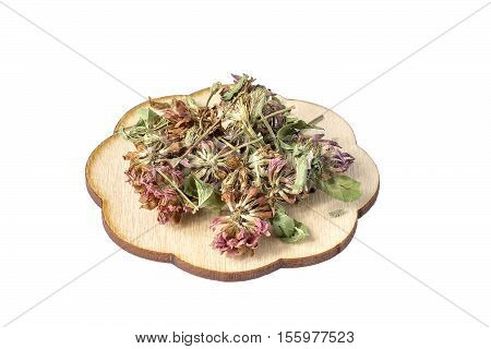 Bundle of dried flowers of clover (Trifolium pratense) isolated on white background. It is used for the preparation of useful herbal tea and medicinal infusions in the herbal medicine