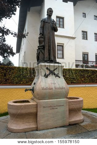 St. Johann, Austria - October 13, 2016: Monument to the dean of the church from 1784 to 1819 Mathias Wishofer. In 1809, Mathias Wishofer saved the city from destruction by the French.
