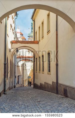 Narrow street with archway in the old town of Olomouc Czech Republic