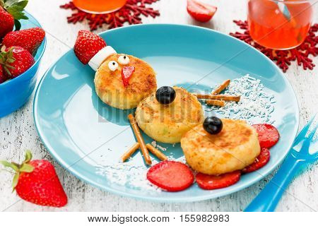 Snowman cottage cheese pancakes for breakfast - Christmas fun food for kids