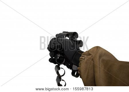 Isolated first person view soldier hand in black battle gloves & tactical jacket holding an empty metal ammo cartridge belt.