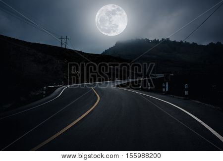 Landscape Of Nighttime With Curvy Roadway In Forest At National Park.  Dark Tone.
