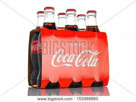LONDON UK - NOVEMBER 07 2016: Classic bottles Of Coca-Cola six pack on white background
