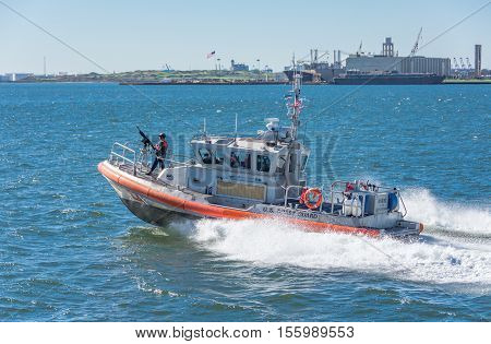 Us Coast Guard Boat Protecting The Staten Island Ferry