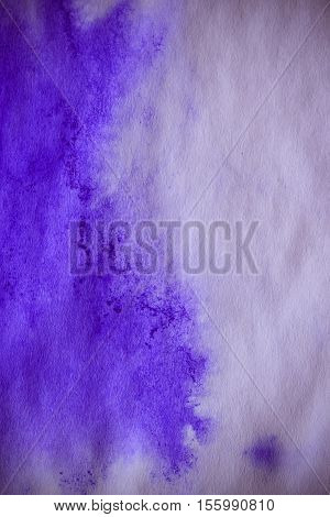Purple ink stain on a sheet of white paper macro. Abstract background. Spreads ink stains with streaks on a white background. Absorb close-up