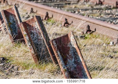 Old standing up rusted railway steel to foreclosure or deposition