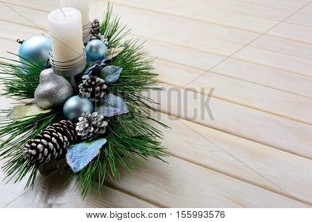 Christmas background with blue ornaments decorated candleholder. Christmas holidays decoration with blue ornaments. Christmas greeting background. Copy space.
