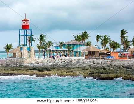 Colorful Cabins, Tower, Palm Trees And Sand