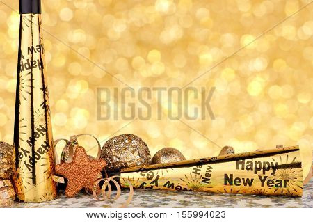 New Years Eve Border Of Party Noise Makers And Golden Decor With Twinkling Light Background