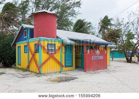 COCO CAY BAHAMAS - OCT 16 2016: Colorful and fun restrooms water closet showers cabins on the Caribbean beach