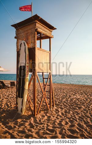 life guard station with red flag and canoe