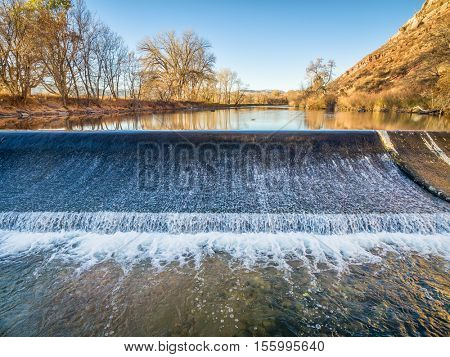 diversion dam on the Poudre River in northern Colorado at Belvue near Fort Collins - aerial view
