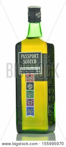 CIRCA NOVEMBER 2016 - GDANSK: Passport Scotch blended whisky isolated on white background. Passport Scotch is a brand of whisky exported from Scotland by Seagram Distillers currently owned by Pernod Ricard.
