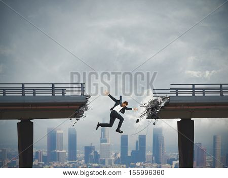 Businessman falls by jumping a broken bridge. crisis concept