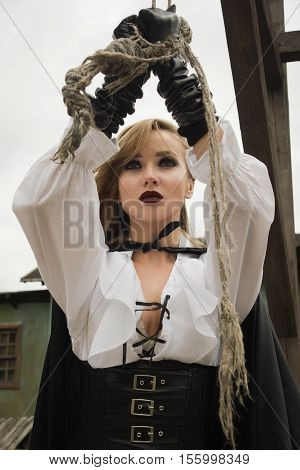 Beautiful Woman In Pirate Style As Prisoner