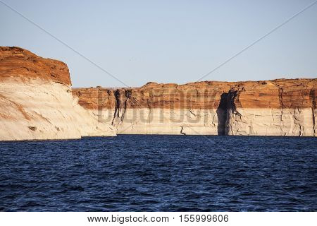 Low water bathtub ring on sandstone cliffs around Lake Powell in Glen Canyon National Recreation Area in Arizona.