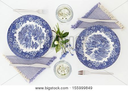 Empty plates and wine glasses romantic dinner for two. Homey atmosphere clean white table. Top view
