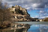 Citadel of Sisteron and Durance River in hiver with clouds in afternoon light. Sisteron and its fortifications is located in the Southern Alps (Alpes de Haute Provence). France poster