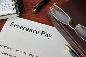 Severance Pay definition written on a paper. poster