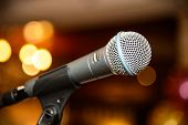 Dynamic microphone for singing. Accessory indispensable singers. Symbol of musical performers. Scenario attribute to performances of artists. Tool for voice karaoke. poster