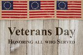Veterans Day greeting USA patriotic old Betsy Ross flag and weathered wood background with text Veterans Day Honoring all who served poster