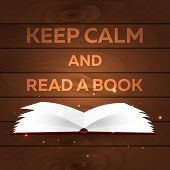 Book poster. Keep calm and read a book. Open book with mystic bright light on wooden background. Vector illustration poster