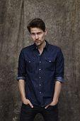 Portrait of denim shirt guy studio shot poster