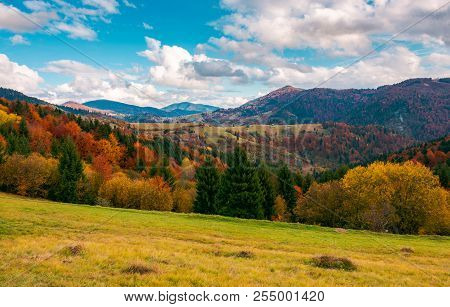 Wonderful Autumn Scenery In Mountains. Beautiful Countryside With Forested Hills And Gorgeous Aftern