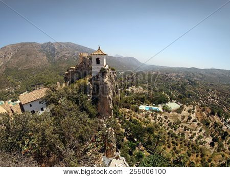 Beautiful View Of The Stunning Bell Tower Perched On The Cliffs At Guadalest Castle. Popular Tourist