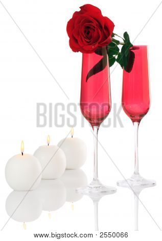 Isolated; Romantic Red Champagne Flutes With Fresh Rose And White Candles