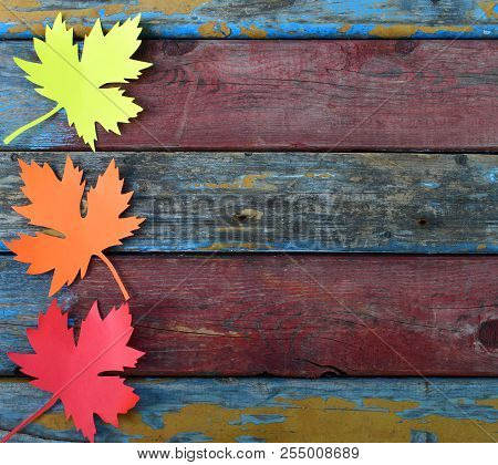 Yellow And Red Paper Maple Leaf On Wooden Background. Hello Autumn Concept. Handmade Crafts. Childre