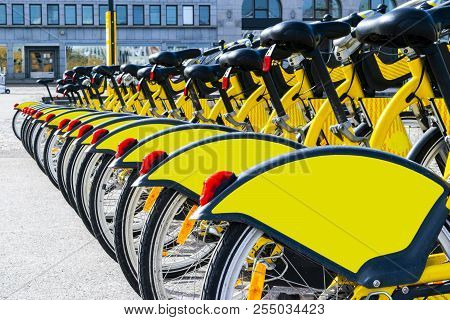 Row Of Bicycles Parked. Row Of Parked Colorful Bicycles. Rental Yellow Bicycles. Pattern Of Vintage