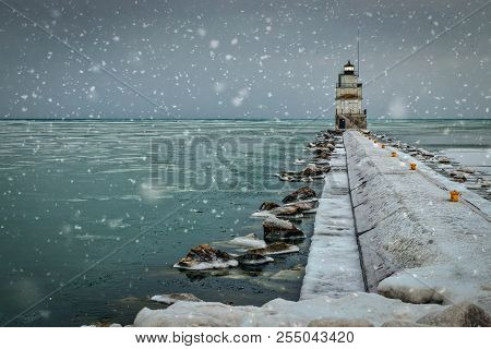December On Lake Michigan At The North Pier And Lighthouse In Manitowoc, Wisconsin.