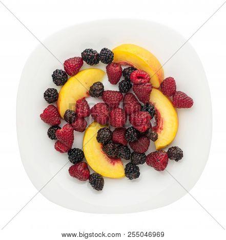 Blackberry, Raspberry, Nectarine On A Plate. Blackberry, Raspberry, Nectarine Isolated On White Back
