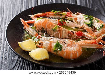 Served Boiled Langoustines, Dublin Bay Prawn, Scampi With Lemon And Melted Butter With Herbs Close-u