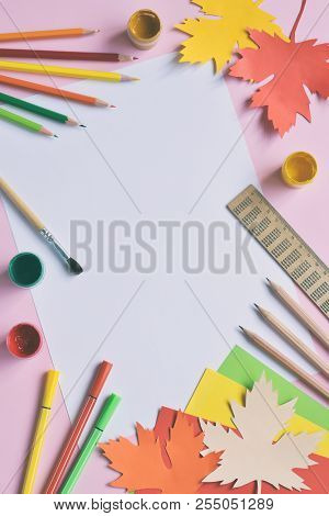 School Accessories And Supplies: Pencils, Paint, Ruler, Paper Maple Leaf, Scissors On A Light Backgr