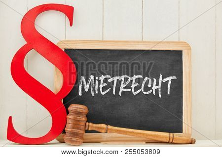 German word Mietrecht (tenancy law) as concept with law book paragraph next to a blackboard
