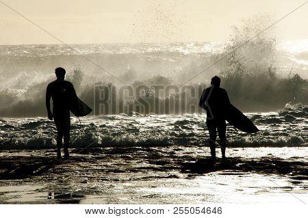 Surfers Silhouette In Ocean - Western Australia