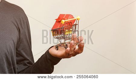 Shopping Cart With Gift In Male Hands Isolated. Shopping, Discount, Sale Concept. Red Gift Box In Sh