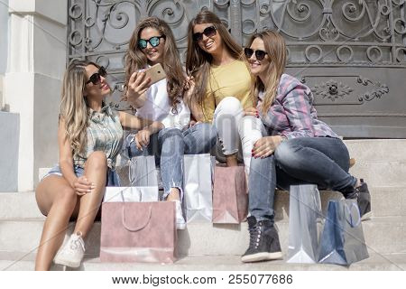 Shopping With A Smile.shopping Fun. Beautiful Girls Talking About Shopping, Girls Talk. Shopping And