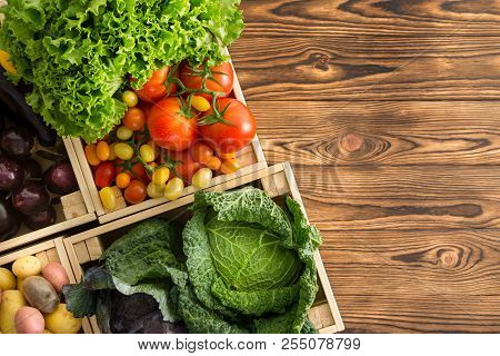 Variety Of Healthy Fresh Vegetables In Boxes Displayed On A Wooden Table Wooden Table At An Organic