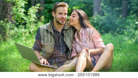 Couple Youth Spend Leisure Outdoors With Laptop. Modern Technologies Give Opportunity To Work In Any
