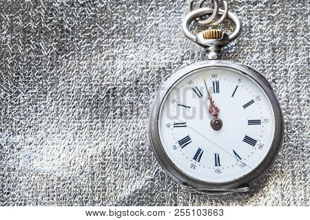 Retro Pocket Watch On Silver Fabric Background