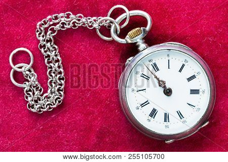 Retro Silver Pocket Watch With Chain On Red Velvet Background