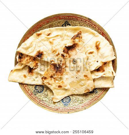 Indian Cuisine - Naan Flat Bread Baked In Tandoor On Brass Plate Isolated On White Background
