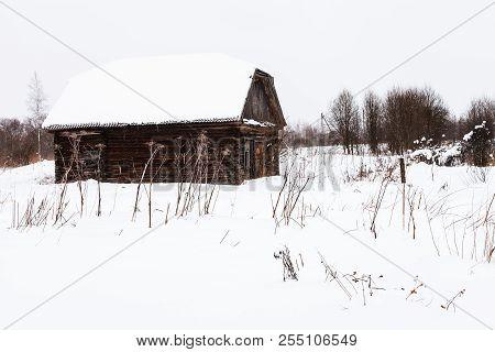 Abandoned Shed In Old Russian Village In Overcast Winter Day In Little Village In Smolensk Region Of