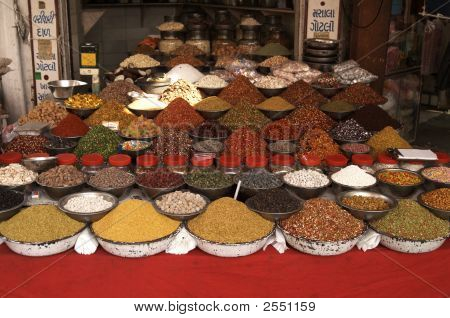 Bowls of nuts pulses and spices on a market stall in Ahmadabad Gujarat India poster