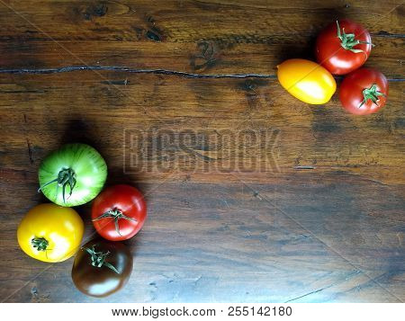 Colourful Heirloon Tomatoes On An Old Wooden Table