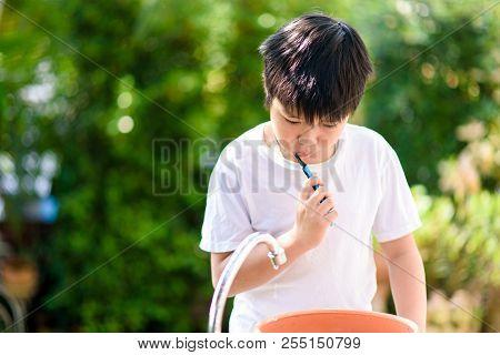 Preteen Asian Boy Brush His Teeth